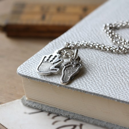 Little hand or Footprint charm on a chain